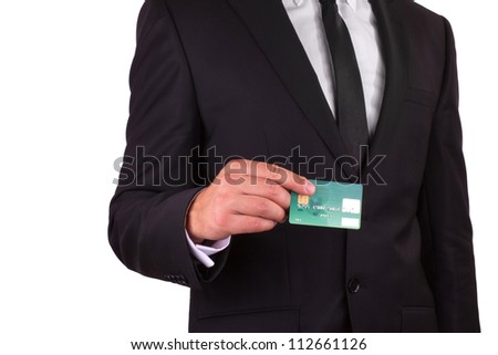 Businessman holding credit card, isolated on white background