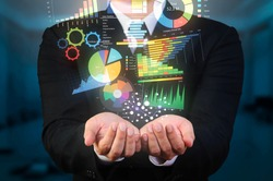 businessman holding data visualization