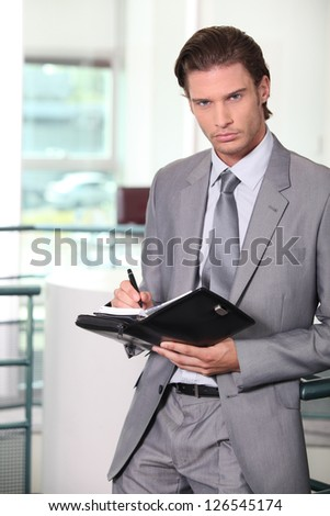 Businessman holding diary