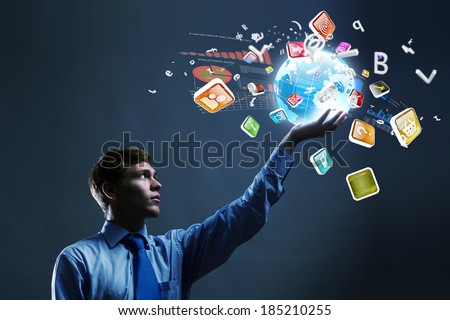 Businessman holding digital Earth planet in hand