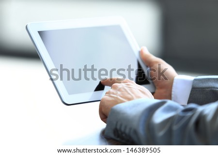 Businessman holding digital tablet #146389505