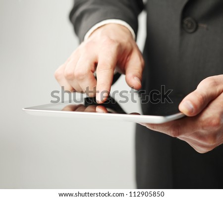businessman holding digital tablet, closeup