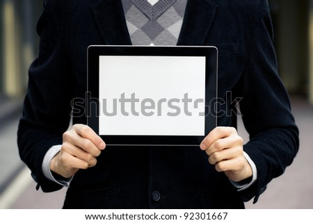 Businessman holding digital tablet pc with blank screen.