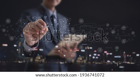 Businessman holding digital tablet with global logistics network and transportation on virtual screen. Smart logistics, E-commerce, Internet of Things, digital marketing, business strategy concept Photo stock ©