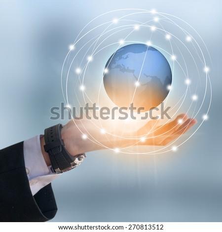 Businessman holding earth #270813512