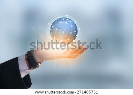 Businessman holding earth