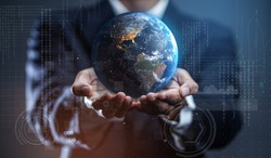 Businessman Holding Earth. Globalization in Business Concept. Elements of this image furnished by NASA