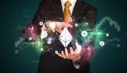 Businessman holding ethereum symbol, investment concept