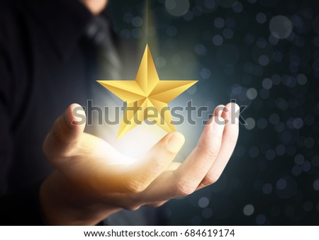 businessman holding excellence star #684619174