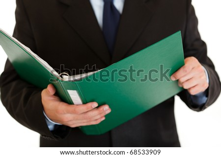 Businessman holding folder with documents in hand isolated on white. Close-up.