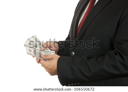 Businessman holding four hundred dollars in his hands