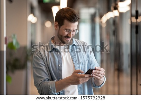 Businessman holding gadget spend free time during break chatting with friend online has informal chat, communicating distantly with client, modern wireless tech everyday usage for fun or work concept