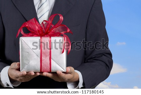Businessman holding gift box