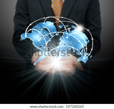 Businessman holding global business