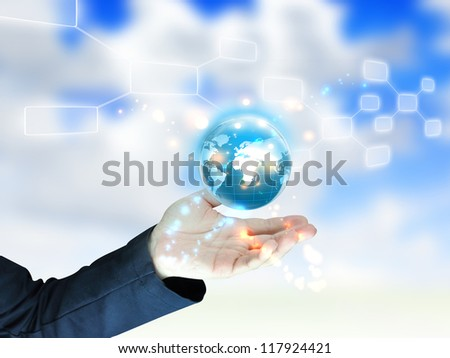 businessman holding globe, connected