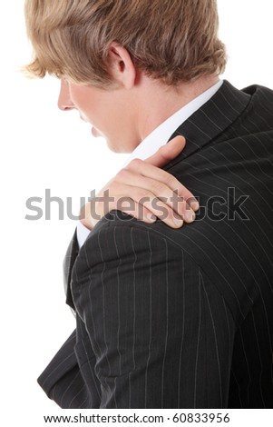 Businessman holding his hand to his aching back