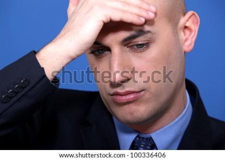 businessman holding his head