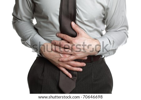 Businessman holding his stomach in pain or indigestion - stock photo