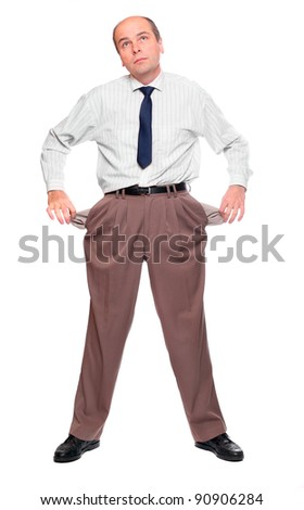 Businessman holding his two empty pockets. Bankruptcy concept.