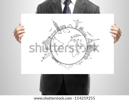 businessman holding in hand placard with earth