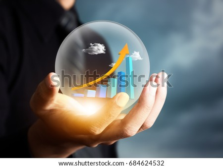 businessman holding increasing graph in crystal ball #684624532