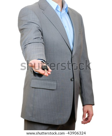 Businessman holding key isolated on white background