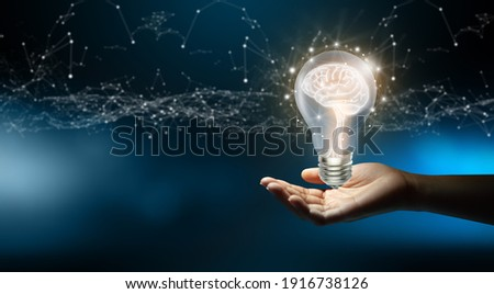 Businessman holding Light bulbs with Brain inside and Low poly wireframe outside. Creative and innovation inspiration. Business Bright idea concept.