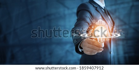 Businessman holding lightbulb and brain with network of business,  Modern executive management's positive attitude, Growth mindset and developed new era in organization.