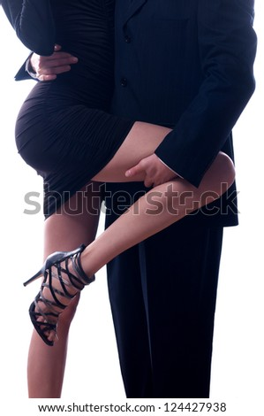 Businessman holding long leg of his secretary isolated on white.