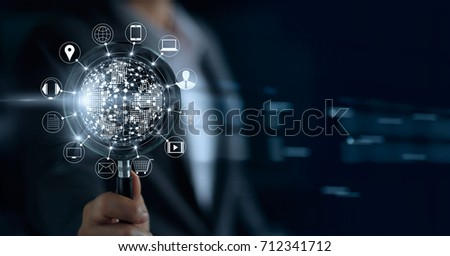Businessman holding magnifying glass, search payments online shopping and icon customer network connection on screen, m-banking and omni channel