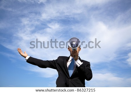 Businessman holding megaphone and cloud background - stock photo