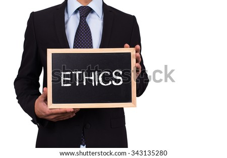 Businessman holding mini blackboard with ETHICS message #343135280
