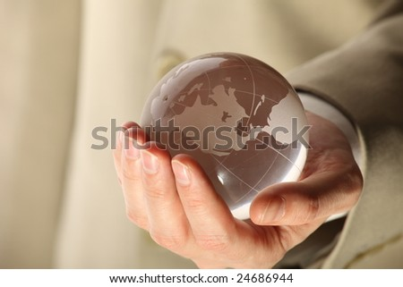 businessman holding mini globe - stock photo