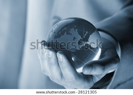 businessman holding mini globe