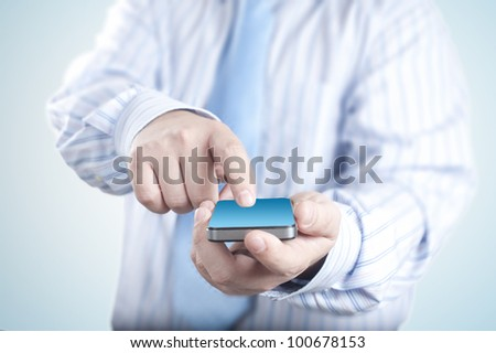 Businessman holding mobile phone. Concept for connectivity, internet, and communication