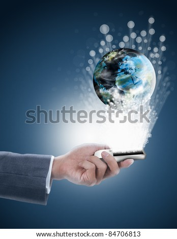 businessman holding mobile phone with globe and fiber optics
