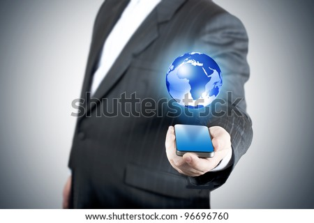 businessman holding mobile phone with globe. Concept for connectivity, internet, and email.