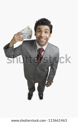 Businessman holding money and smiling