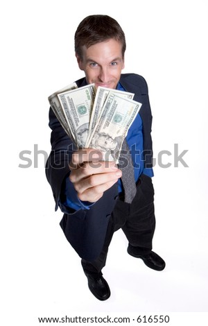 Businessman holding money up to his face - stock photo