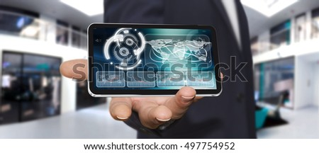 Businessman holding multimedia tech devices in his hand 3D rendering