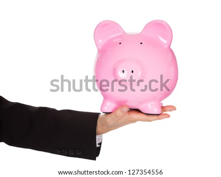 Businessman holding out a piggybank. Isolated on white