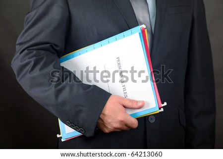 Businessman holding Personnel Files folder
