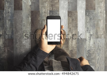 Businessman holding phone