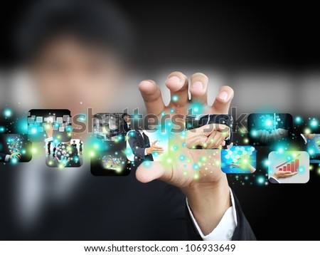 Businessman holding picture