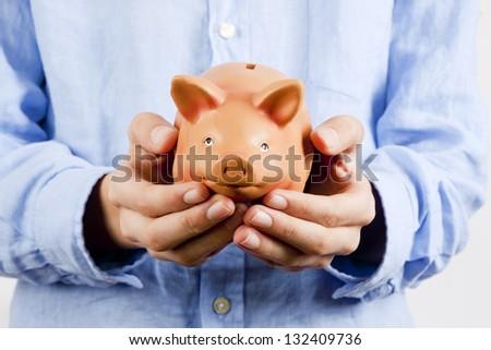 businessman holding piggy bank savings