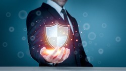 Businessman holding shield protect icon for internet firewall, insurance, or computer virus cleaner. Concept cyber security safe your data.