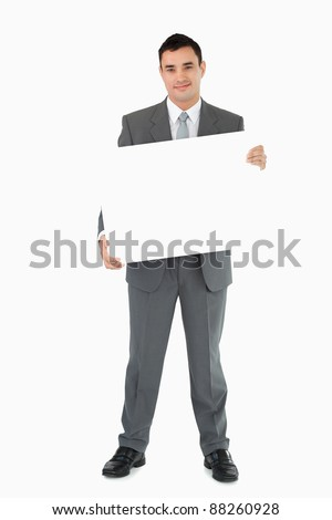 Businessman holding sign against white background - stock photo