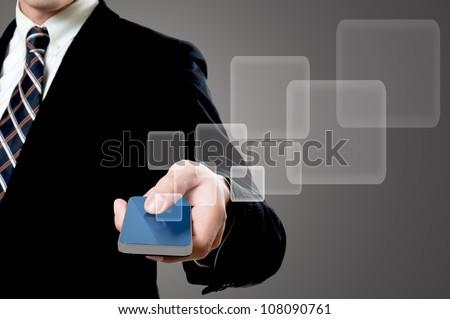 Businessman holding smartphone in studio