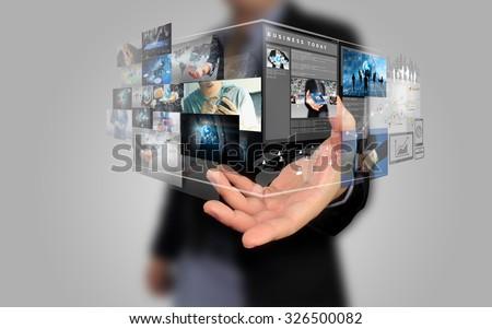 Shutterstock businessman holding social media concept.