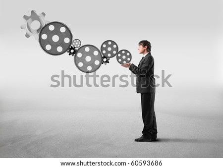 Businessman holding some mechanisms in his hands